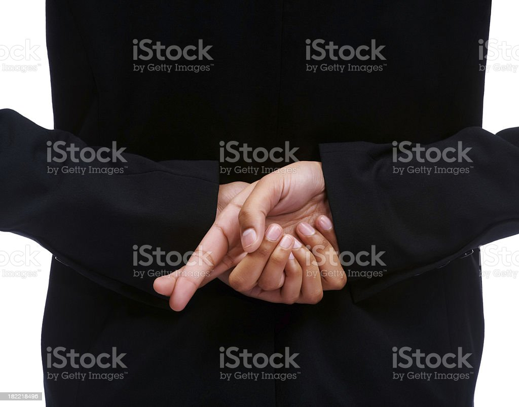 Midsection of businesswoman crossing fingers royalty-free stock photo
