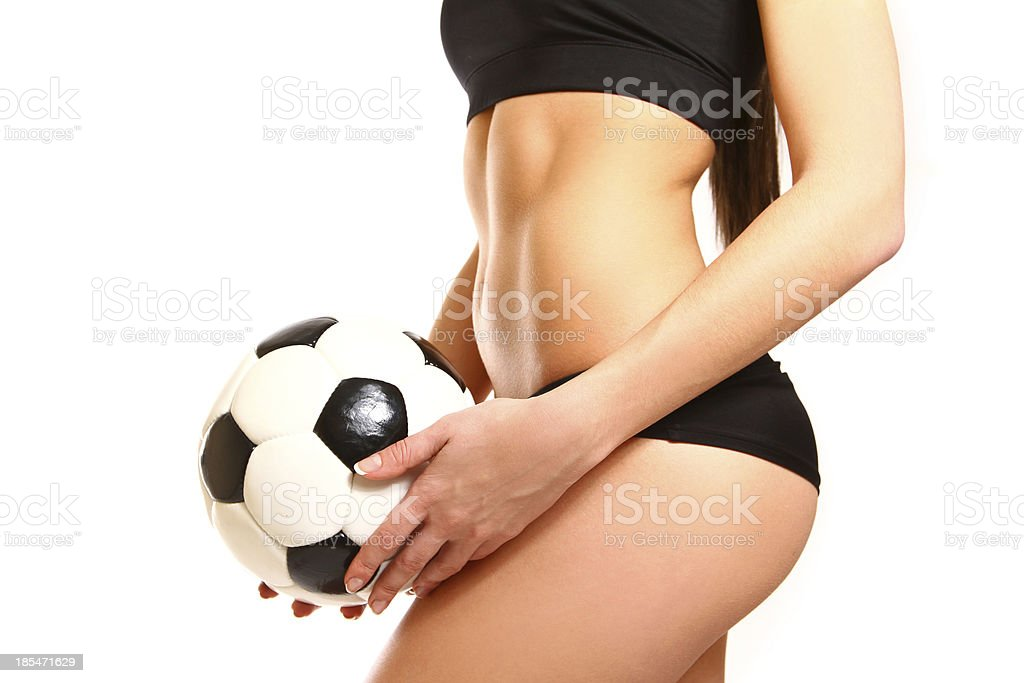 Midsection of fit woman in sportswear with soccer ball standing royalty-free stock photo