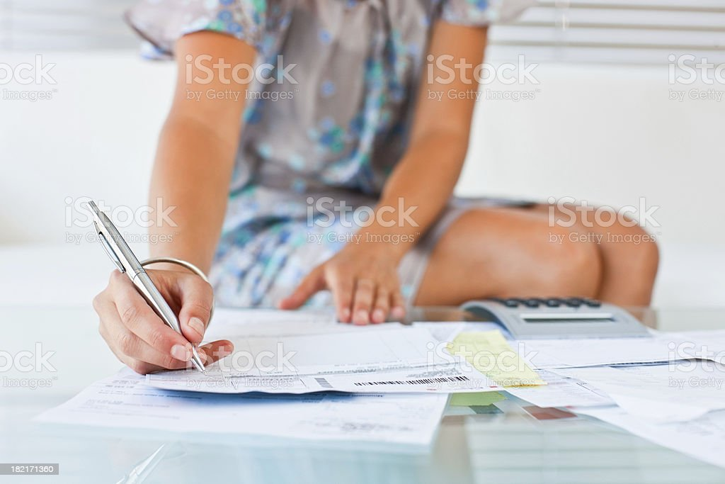 Midsection of lady working on her household bills royalty-free stock photo