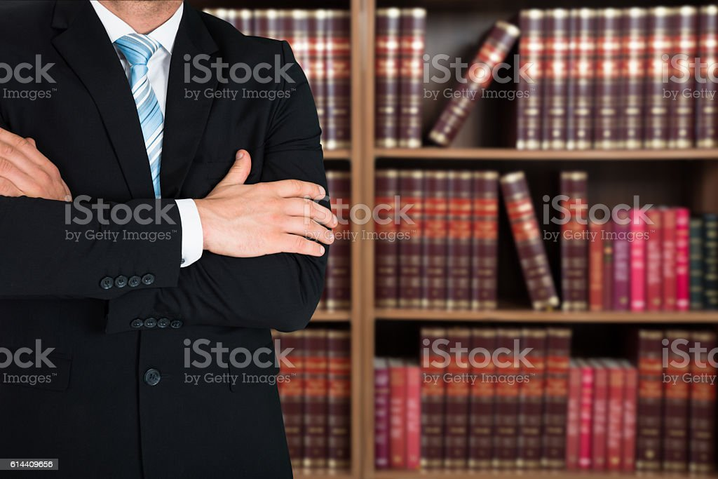 Midsection Of Lawyer With Arms Crossed stock photo