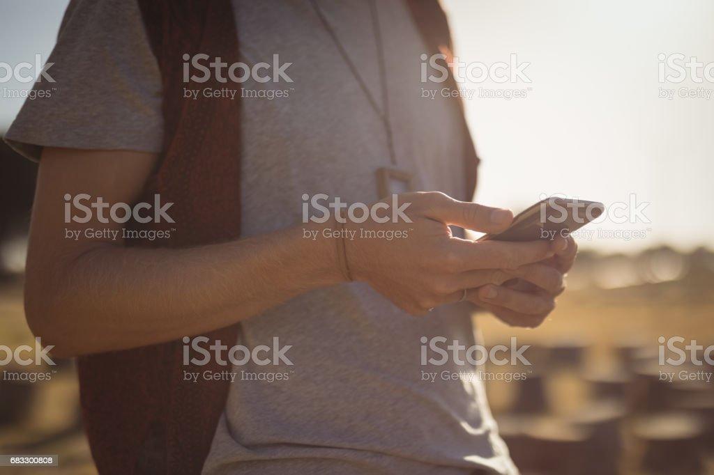 Midsection of man using phone zbiór zdjęć royalty-free