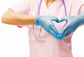 Midsection of nurse making heart shape with hands isolated over white background. Horizontal shot.