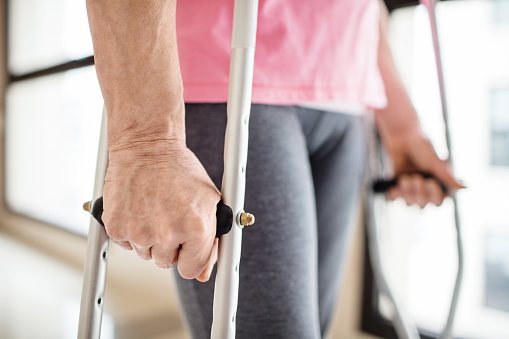 Midsection Of Patient With Crutches In Hospital Stock Photo - Download Image Now