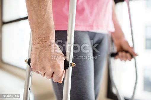 Midsection Of Patient With Crutches In Hospital Stock Photo & More Pictures of 70-79 Years