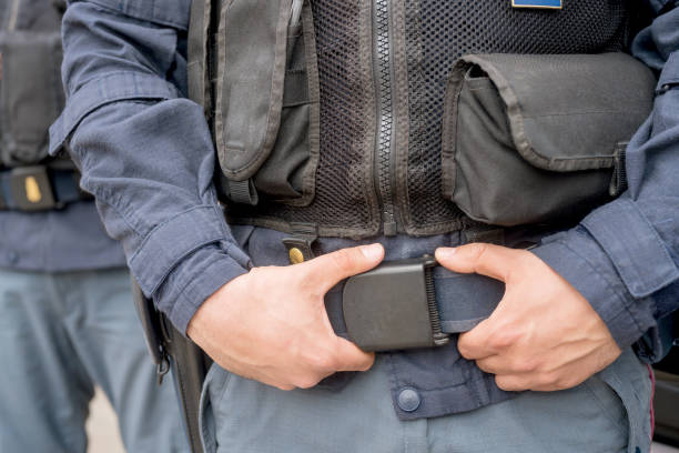 Midsection of police forces outdoors stock photo