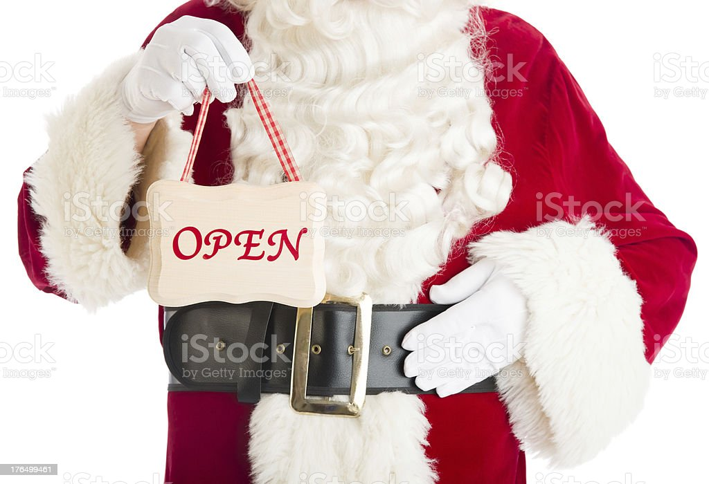 Midsection Of Santa Claus Holding Open Sign royalty-free stock photo