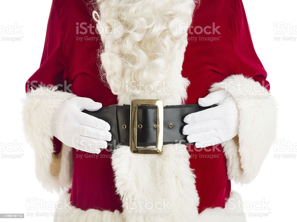 Midsection Of Santa Claus With Hands On Stomach royalty-free stock photo
