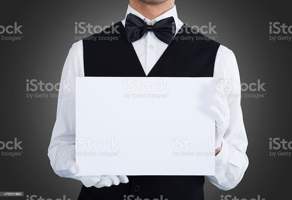 Midsection Of Waiter Holding Blank Billboard stock photo