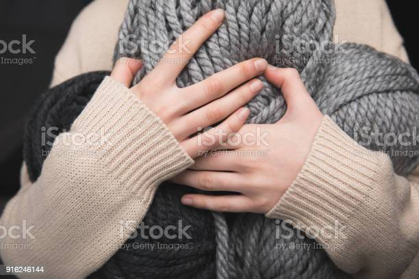 Midsection of woman holding grey yarn balls in hands on black picture id916246144?b=1&k=6&m=916246144&s=612x612&h=an0thuif4v91qgowvc1scbyamqlqwegcodgp2z hsdy=