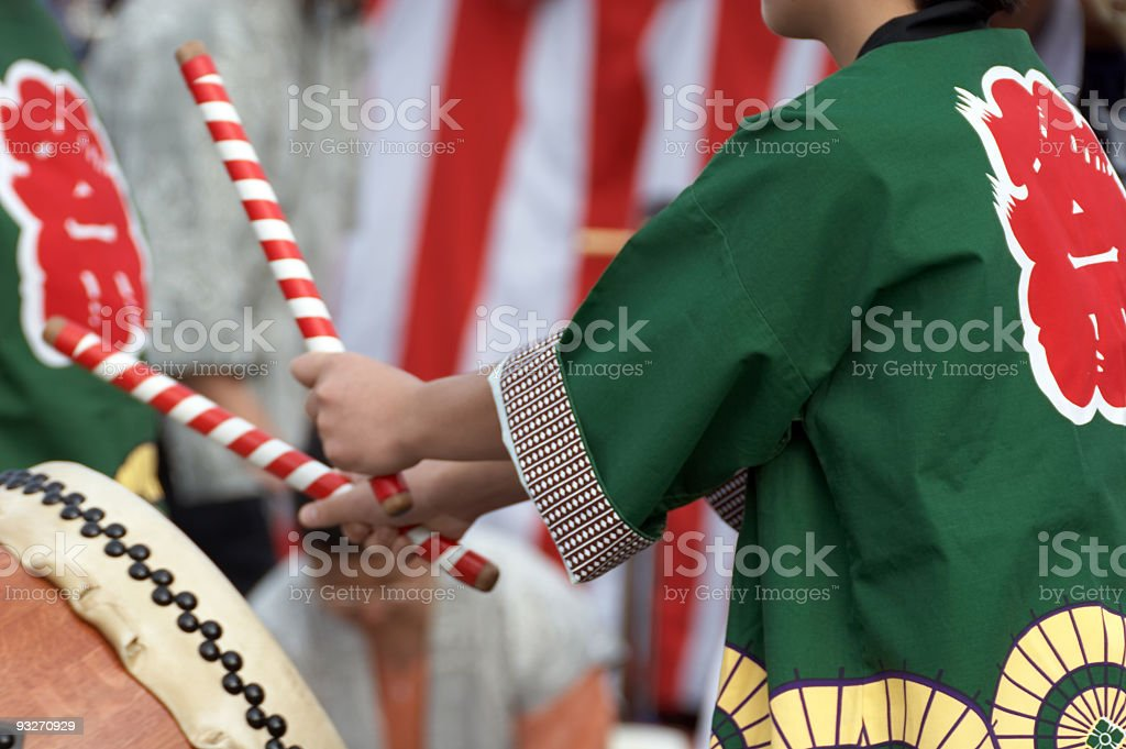 Midsection rear view of a child playing the Taiko drums stock photo