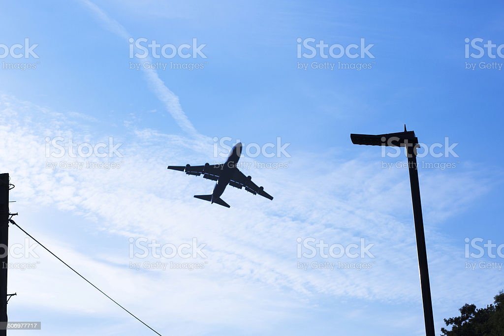 Mid-sized  airplane flying above clouds. stock photo