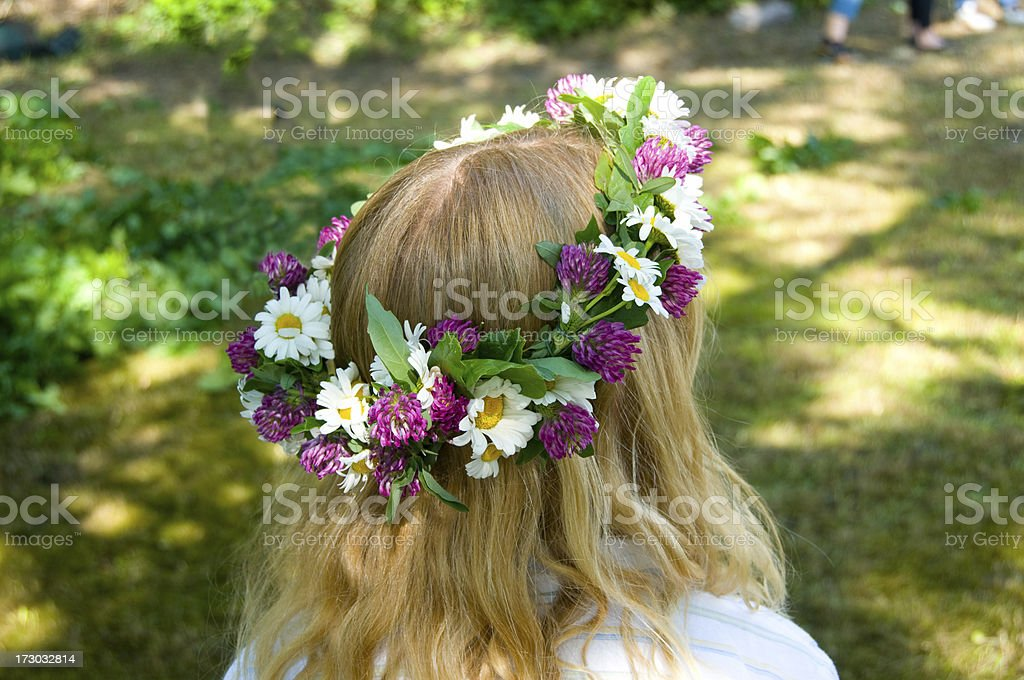 Midsommer girl with flowers in her hair stok fotoğrafı