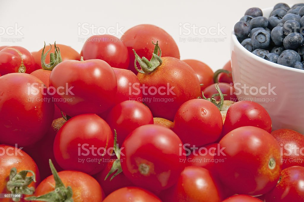mid-summer tomatoes and blueberries royalty-free stock photo