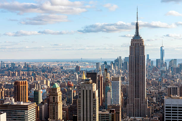 Midtown and Lower Manhattan Skyline, New York, USA Midtown and Lower Manhattan skyline with Empire State Building and One World Trade Center, elevated view, New York City, USA. empire state building stock pictures, royalty-free photos & images