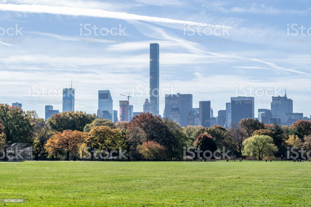 Midtown from the Great lawn in Central park in the fall season stock photo