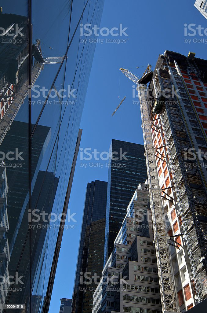 Midtown Manhattan Cityscape, Construction Crane, Skyscrapers, New York City royalty-free stock photo