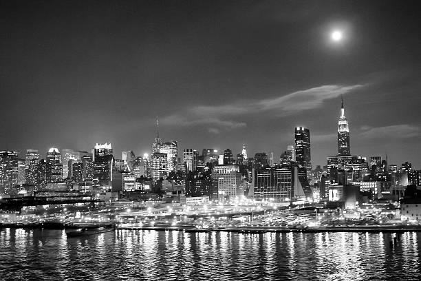Midtown Manhattan coast illuminated bw stock photo