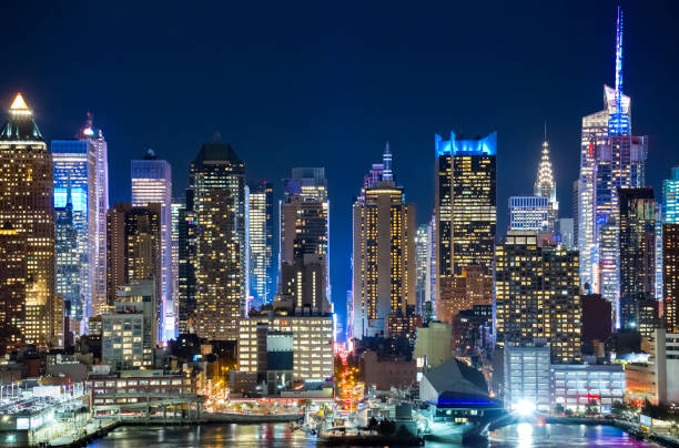 Midtown Manhattan skyline at night stock photo