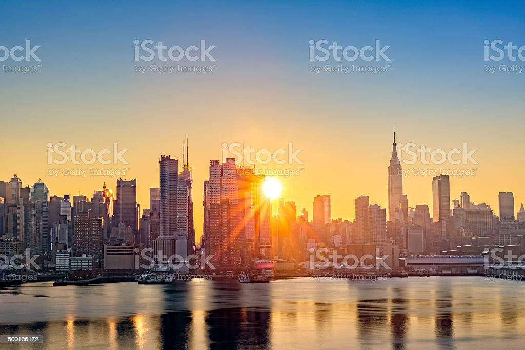Midtown Manhattan skyline at sunrise stock photo