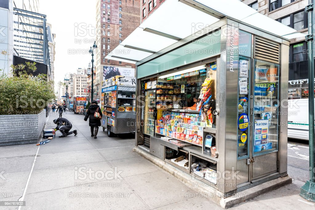 Midtown Manhattan with street sidewalk on Broadway, Newsstand with newspaper, magazines, candy stock photo