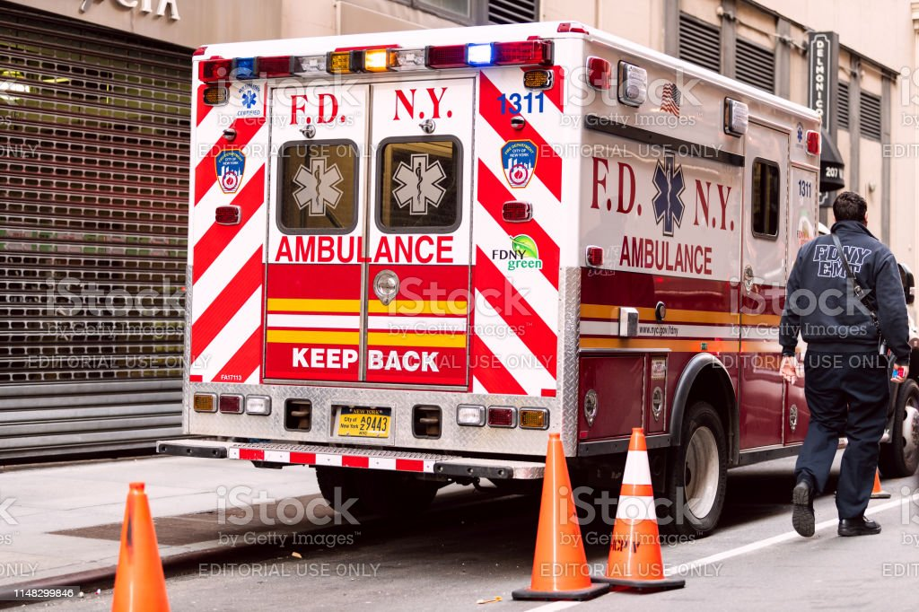 New York City April 6 2018 Nyc Midtown With Fdny Red Ambulance Truck