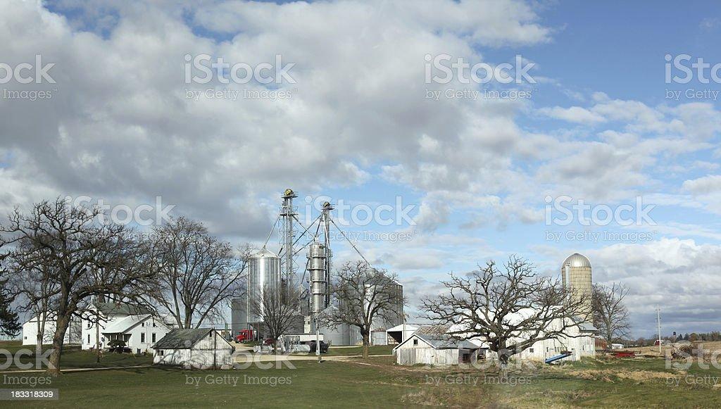 Midwest farm in USA.  Grain bins, elevators, barns, silo.  Panorama. royalty-free stock photo