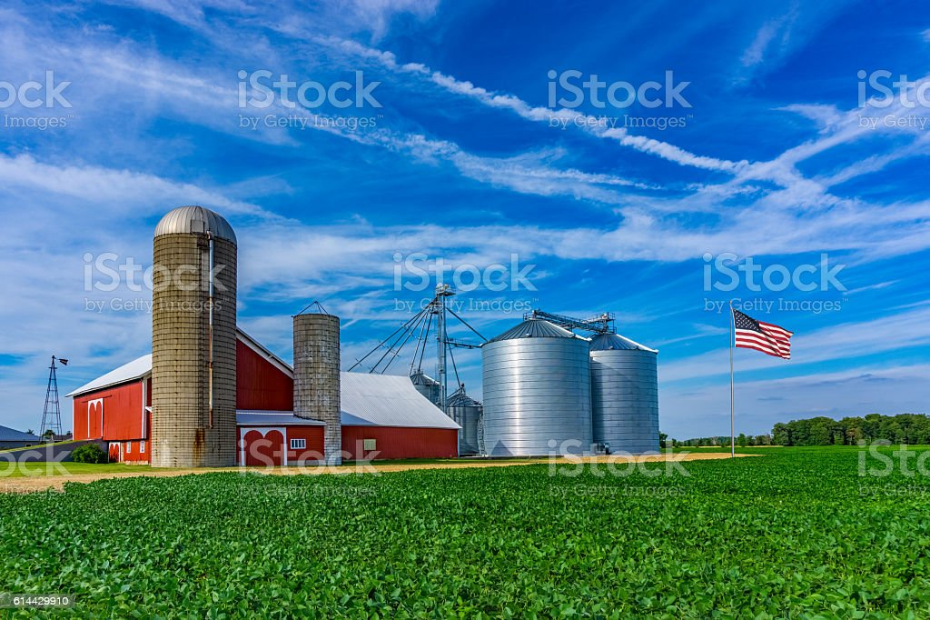 Midwest farm with spring  crop and red barn,Indiana stock photo