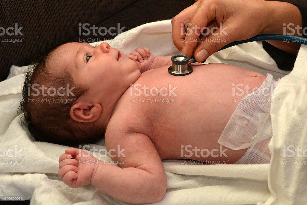 Midwife checks newborn baby stock photo