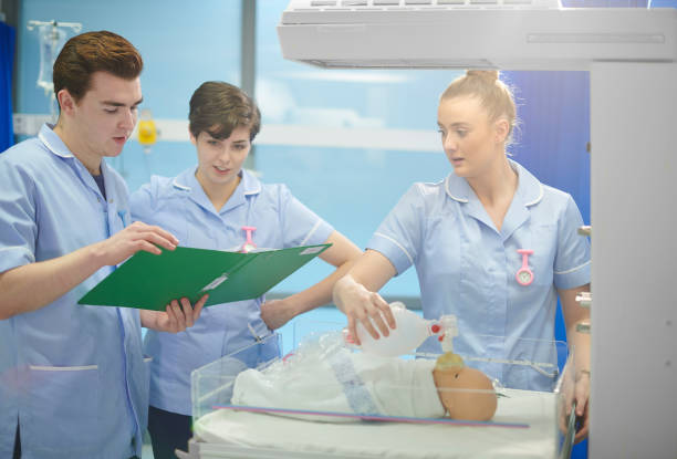 midwifery students - midwife stock pictures, royalty-free photos & images