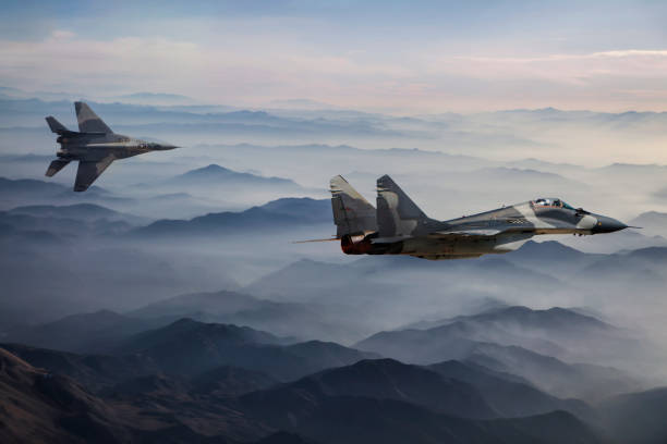 Mig-29 Fighter Jets in Flight above the fogy mountains stock photo