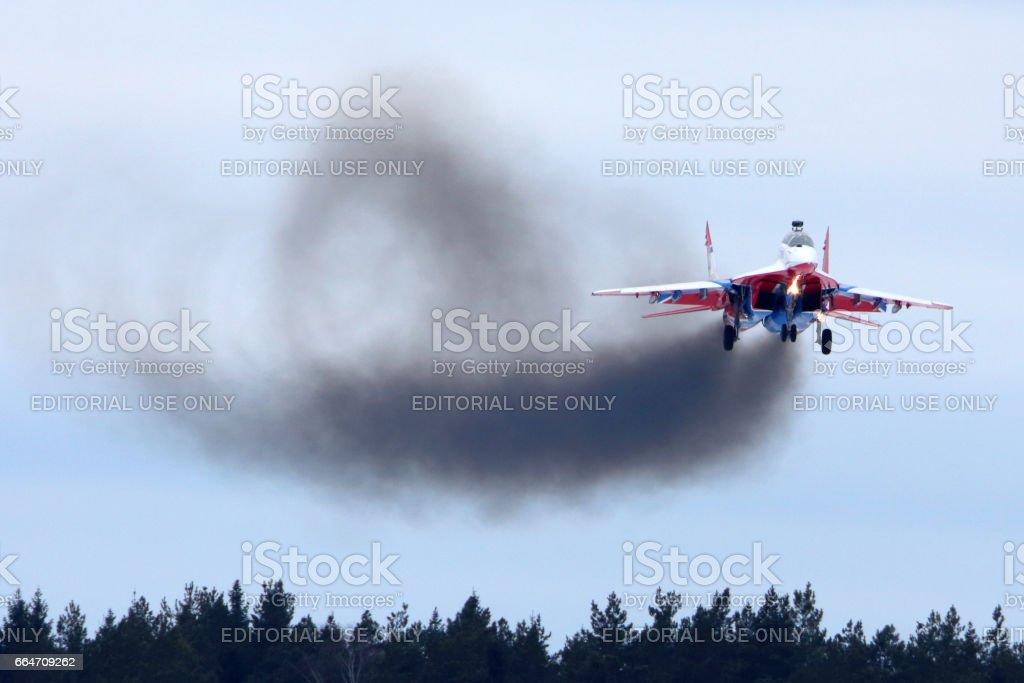 MiG-29UB jet fighter performing go around exercise at Kubinka air force base. stock photo