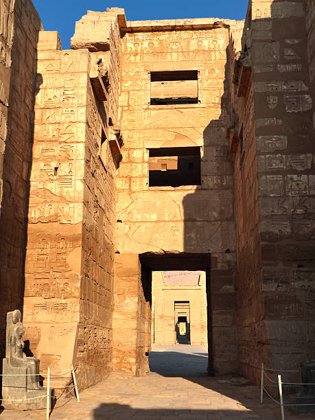 """Migdol Gate, Medinet Habu, Theban Necropolis, Luxor, Egypt """"The High Gate, or Migdol Gate, of Medinet Habu, the mortuary temple of the 12th century BC pharaoh Ramesses III (also Ramses, Rameses and Usermaatre-meryamun).  Modelled on an Asiatic migdol (or fortress) the gate is fronted by guardhouses and decorated with scenes of the pharaoh defeating his enemies.  Located on the West Bank in the southern part of the Theban necropolis, Medinet Habu is one of the finest temples in Egypt."""" Tomb Of Ramses III stock pictures, royalty-free photos & images"""