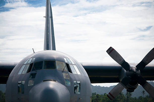 Mighty Hercules Front view of a Hercules C130. military airplane stock pictures, royalty-free photos & images