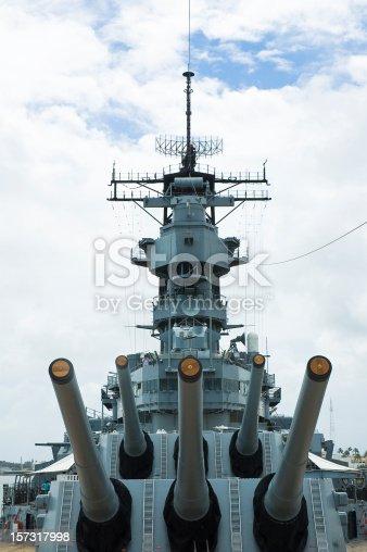 A symmetrical view of the big guns on the battleship USS Missouri.