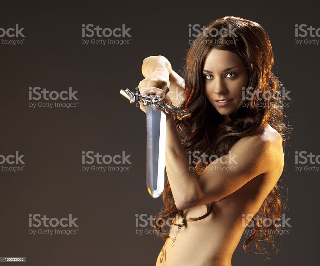 Mighty Warrior Maiden Brandishing Broad Sword royalty-free stock photo