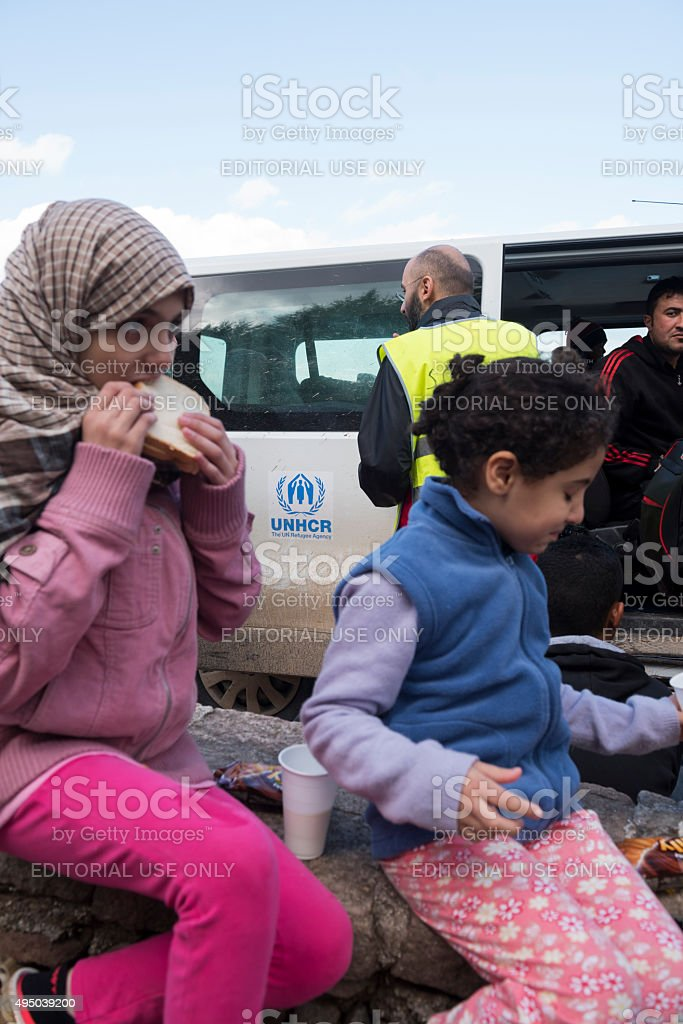 Migrant children arriving in Europe stock photo