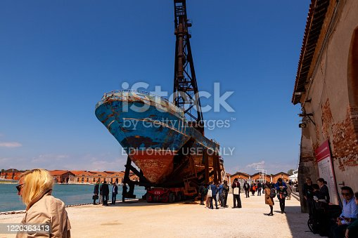 Venice, Italy - May, 10: Migrant Death Ship by Christoph Büchel, titled Barca Nostra exposed at the Arsenal during the 58th International Art exhibition of Venice biennale on May 10, 2019