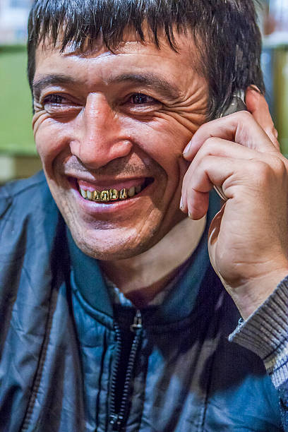 migrant worker, gastarbeiter - gold tooth stock photos and pictures