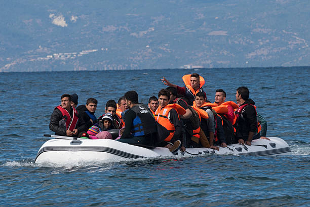 Migrants traveling from Turkey to Greece stock photo