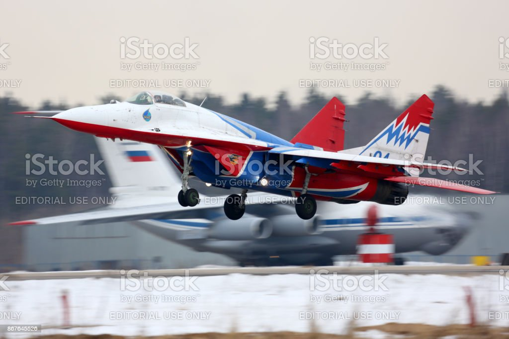 Mikoyan Gurevich MiG-29 of Swifts aerobatics team taking off at Kubinka air force base. stock photo
