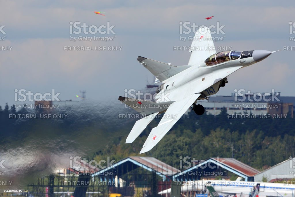 Mikoyan Gurevich MiG-35 747 BLUE of russian air force perfoming demonstration flight in Zhukovsky during MAKS-2015 airshow. stock photo