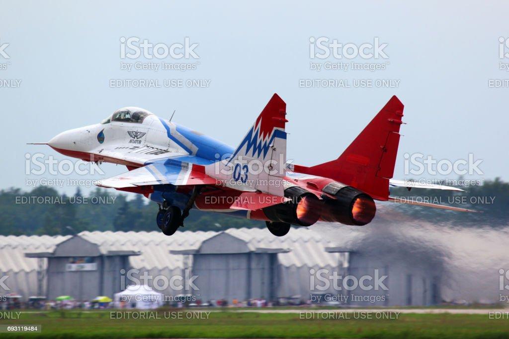 Mikoyan MiG-29 03 Blue jet fighter taking off at Kubinka air force base. stock photo