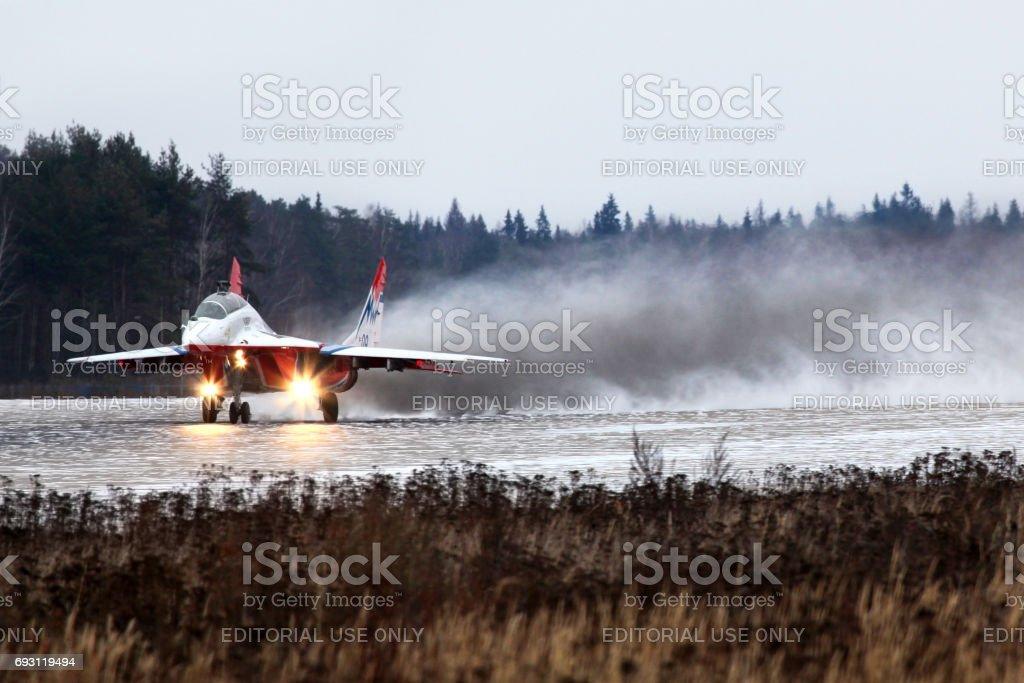 Mikoyan MiG-29UB 09 BLUE jet fighter taking off at Kubinka air force base. stock photo