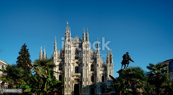 Milan Cathedral, palm and clear sky. Milan, Italy