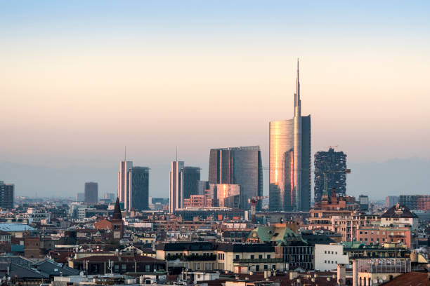milan cityscape at sunset with new skyscrapers of porta nuova financial and business district - milano foto e immagini stock