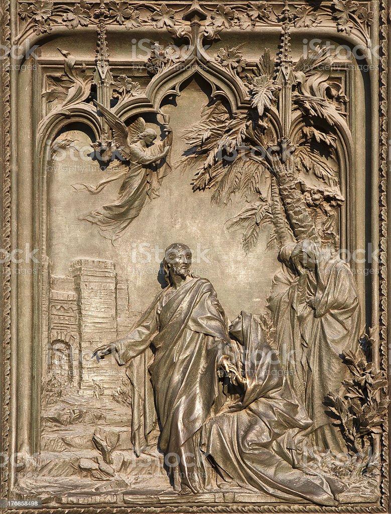 Milan - detail from Porta maggiore del Duomo stock photo
