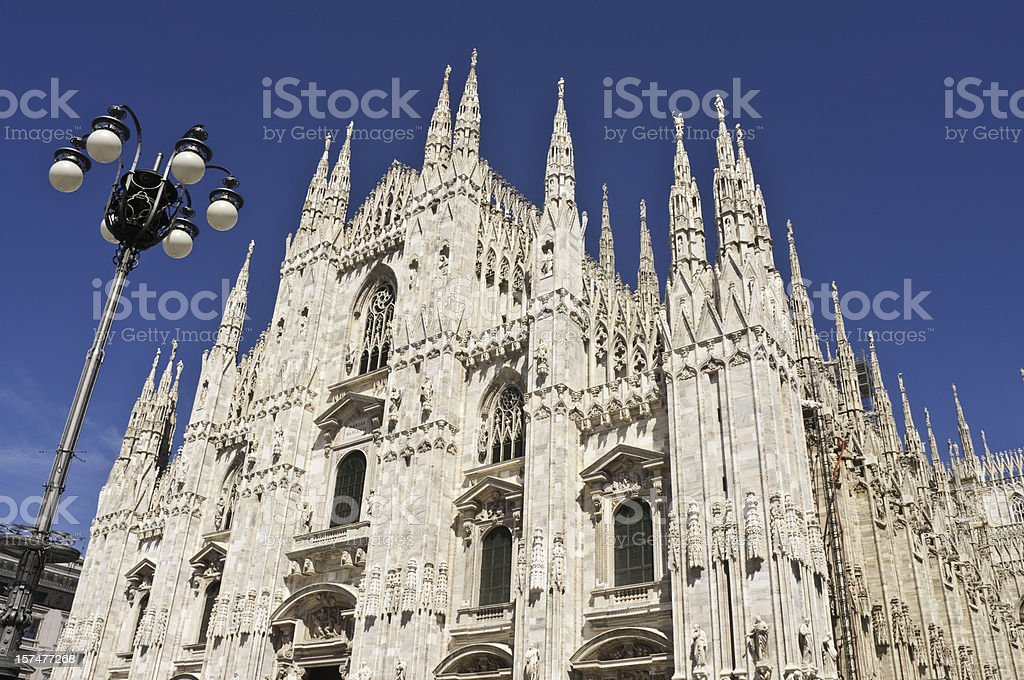 Milan Duomo ornate facade soaring spires royalty-free stock photo