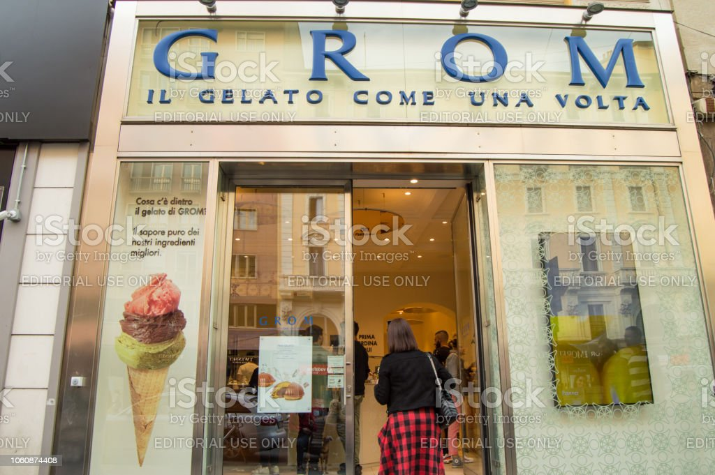 Milan, Italy Gelateria GROM, 05 October 2018 Glass showcase and entrance to the Italian ice cream parlor.