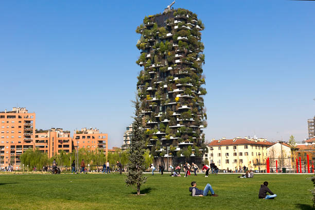 Milan - People enjoy in a spring day in Porta Nuova District, a good time in the large green park. Lombardy Italy stock photo