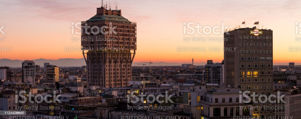 Milan cityscape at sunset with the skyscrapers Torre Velasca and...